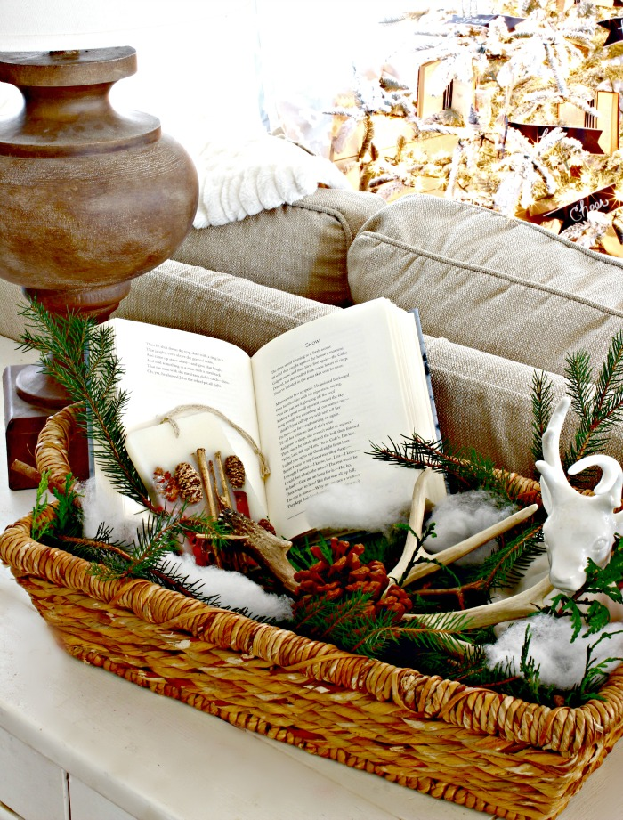 Robert Frost Snow Poem with greenery, antlers and pinecones in basket - www.goldenboysandme.com