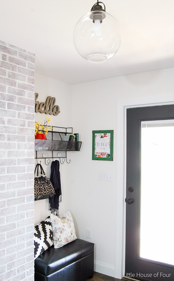 Pops of yellow and red are the perfect spring addition to this beautiful mudroom. - LITTLE HOUSE OF FOUR