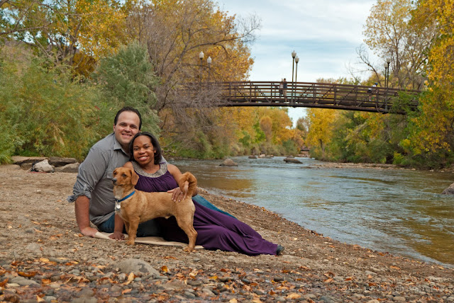 a colorful photograph of a happy couple in colorado for a maternity session, with vibrant fall colors along ariver