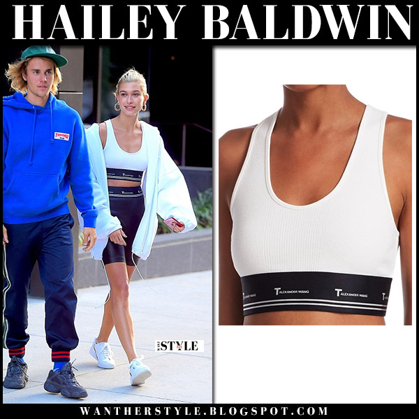 Hailey Baldwin in white crop top alexander wang and black bike shorts with justin model street style july 12