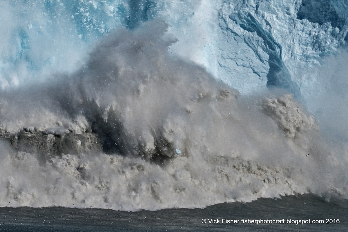 Glacier calving iceberg ice Eqi Eqip Sermia climate change global warming melting gigantic huge tsunami travel adventure spectacular tourist tourism vacation Denmark Danish Greenlandic nature wilderness pristine unspoiled wild untouched natural