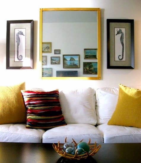 sehorse diptych above sofa