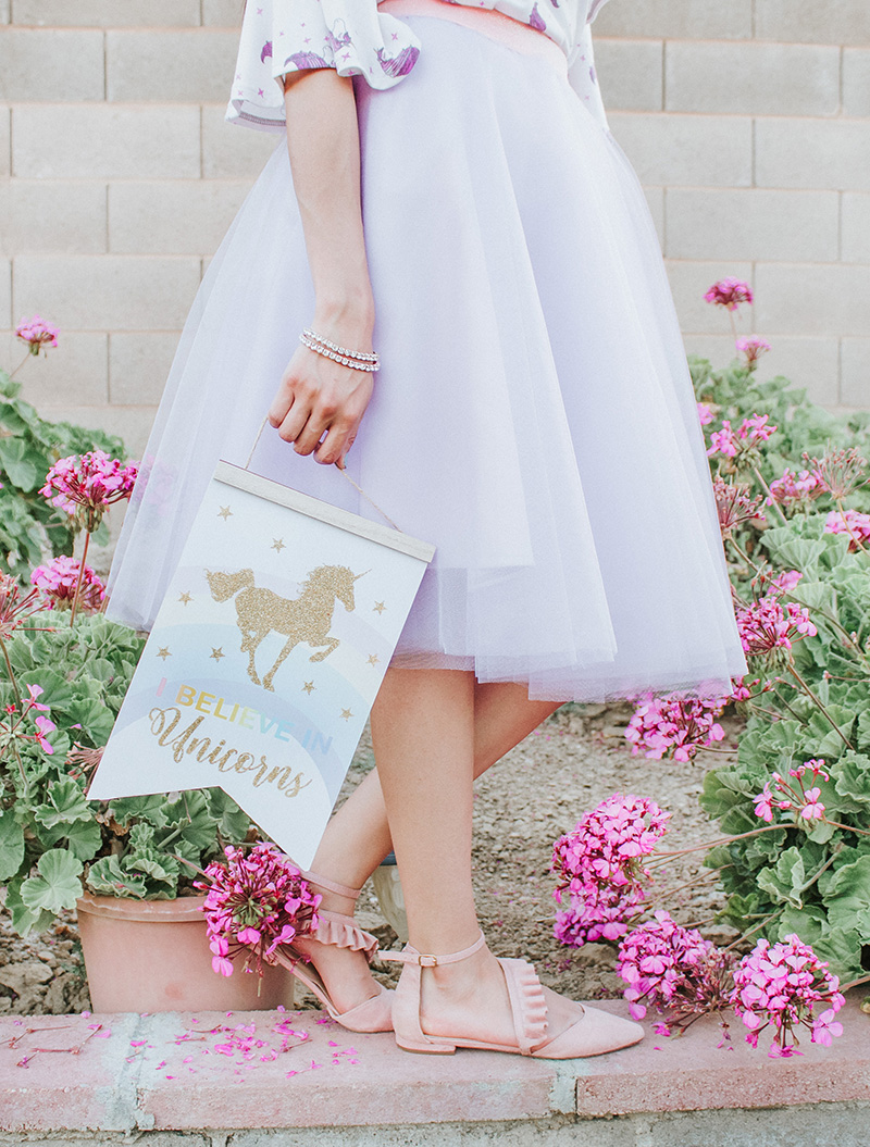 lavender tulle skirt with unicorns sign