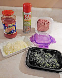 Ingredients to cook with; fresh ground beef, spinach, tomato sauce, cheese and Pam spray.