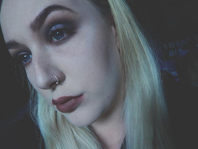 A dark smokey eye with a hint of purple