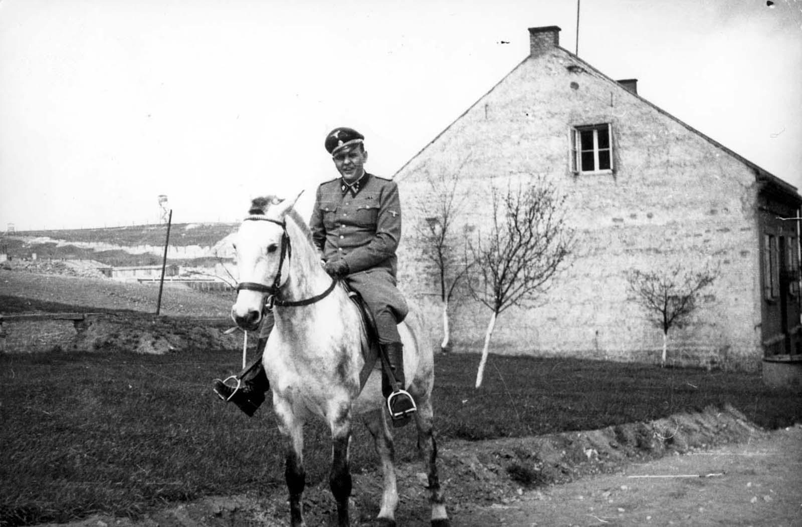 Camp Commandant Amon L. Goeth, riding a horse. Plaszow, Poland.
