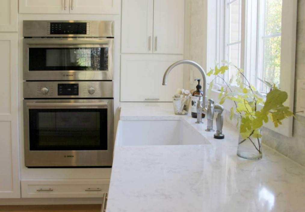 White modern farmhouse kitchen with quartz countertop (Viatera Minuet) by Hello Lovely Studio