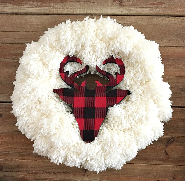 Vintage, Paint and more... a diy yarn wreath with a buffalo plaid wood deer used in a rustic farmhouse Christmas mantel