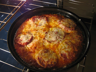 pan with chicken parmigiana in oven