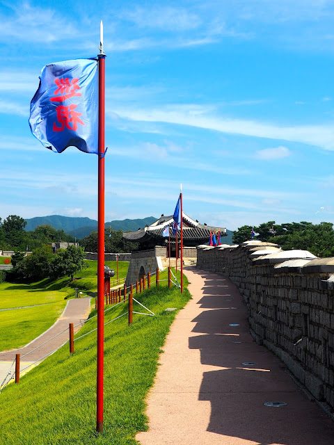 Blue flags along the Hwaseong Fortress walls around Suwon, Gyeonggi-do, South Korea