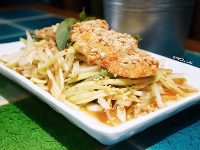 Rice crackers served with Salad of Crunchy Green Mango, Prawns, Pork Belly and Crushed Peanuts - RM14.90
