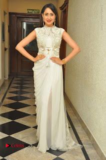 Actress Pragya Jaiswal Stills in Beautiful White Dress at turodu Audio Launch  0058.JPG