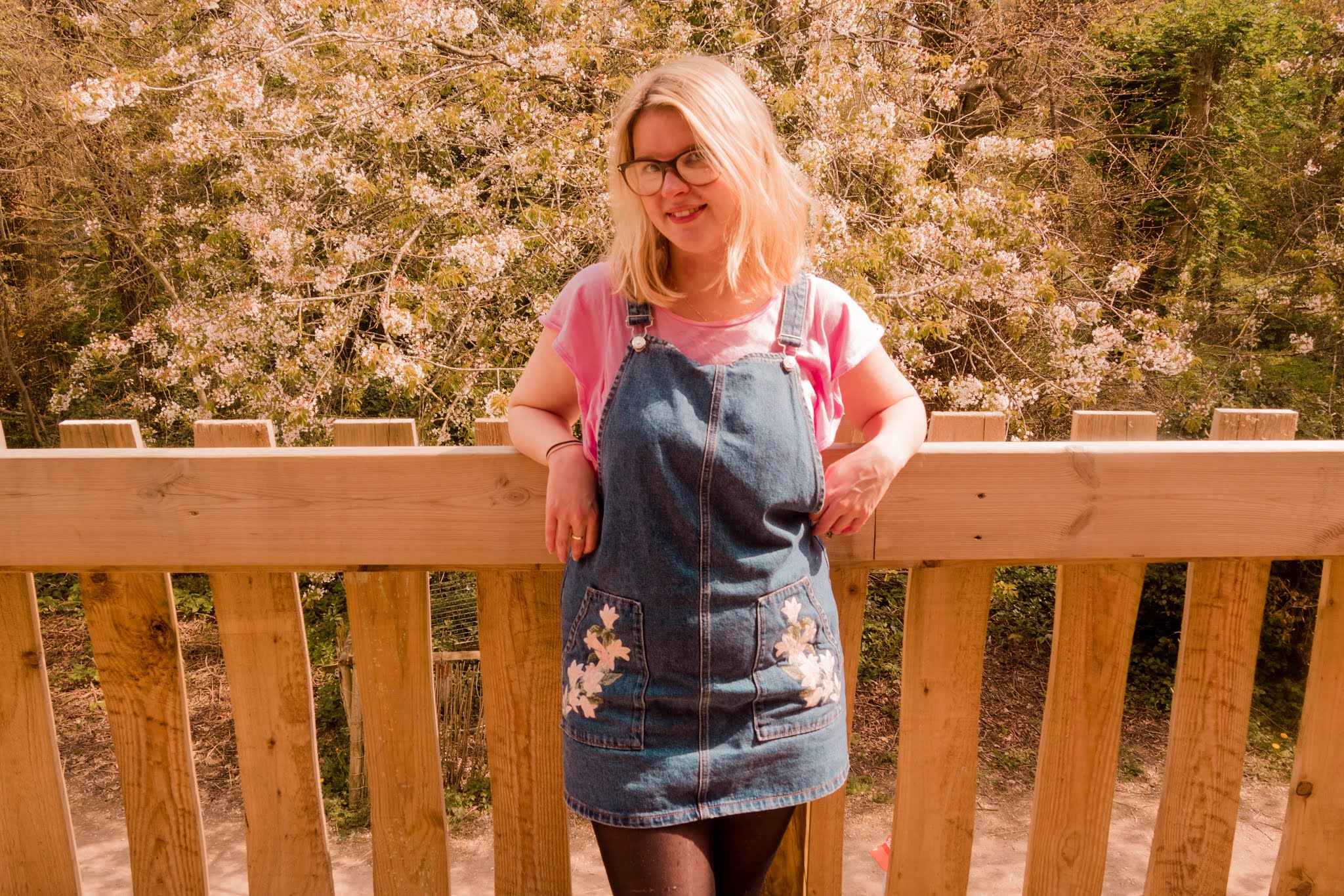 Fashion blogger Chloe Harriets wearing a denim dress and pink tee - article on trying