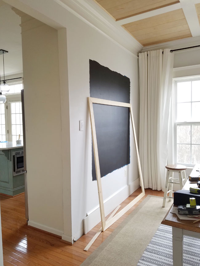 office space with chalkboard - kitchen in the background