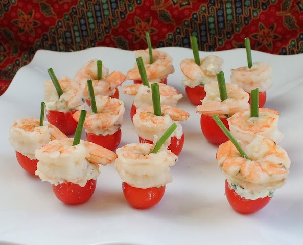 Food Lust People Love: Feta-Stuffed Cherry Tomatoes with Shrimp are exactly what they sound like: Cherry tomatoes filled with seasoned feta and topped with shrimp make one of the prettiest, easiest appetizers you can serve.