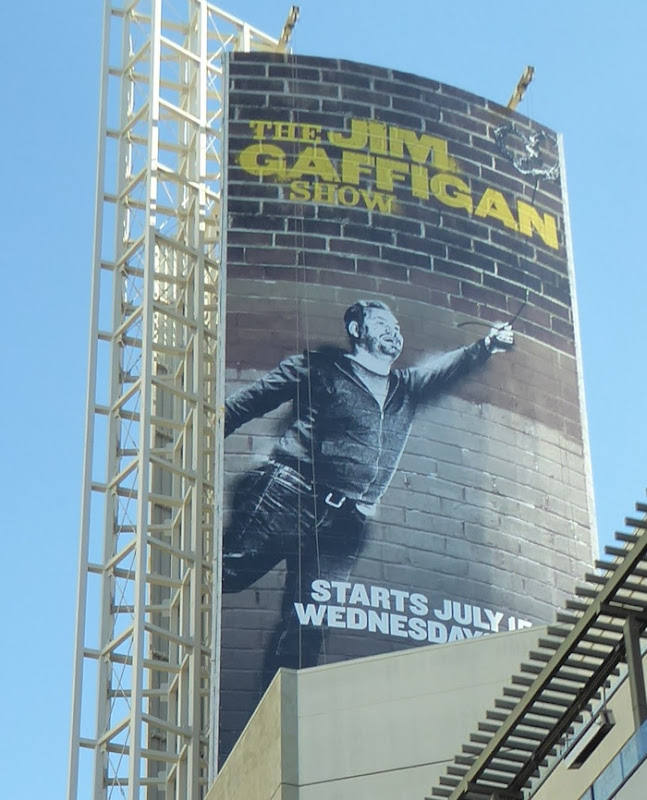 Jim Gaffigan Show Banksy homage billboard