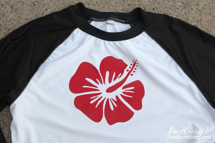 Protect yourself from the rays of the sun with a custom rashguard shirt with tropical hibiscus flower in red.