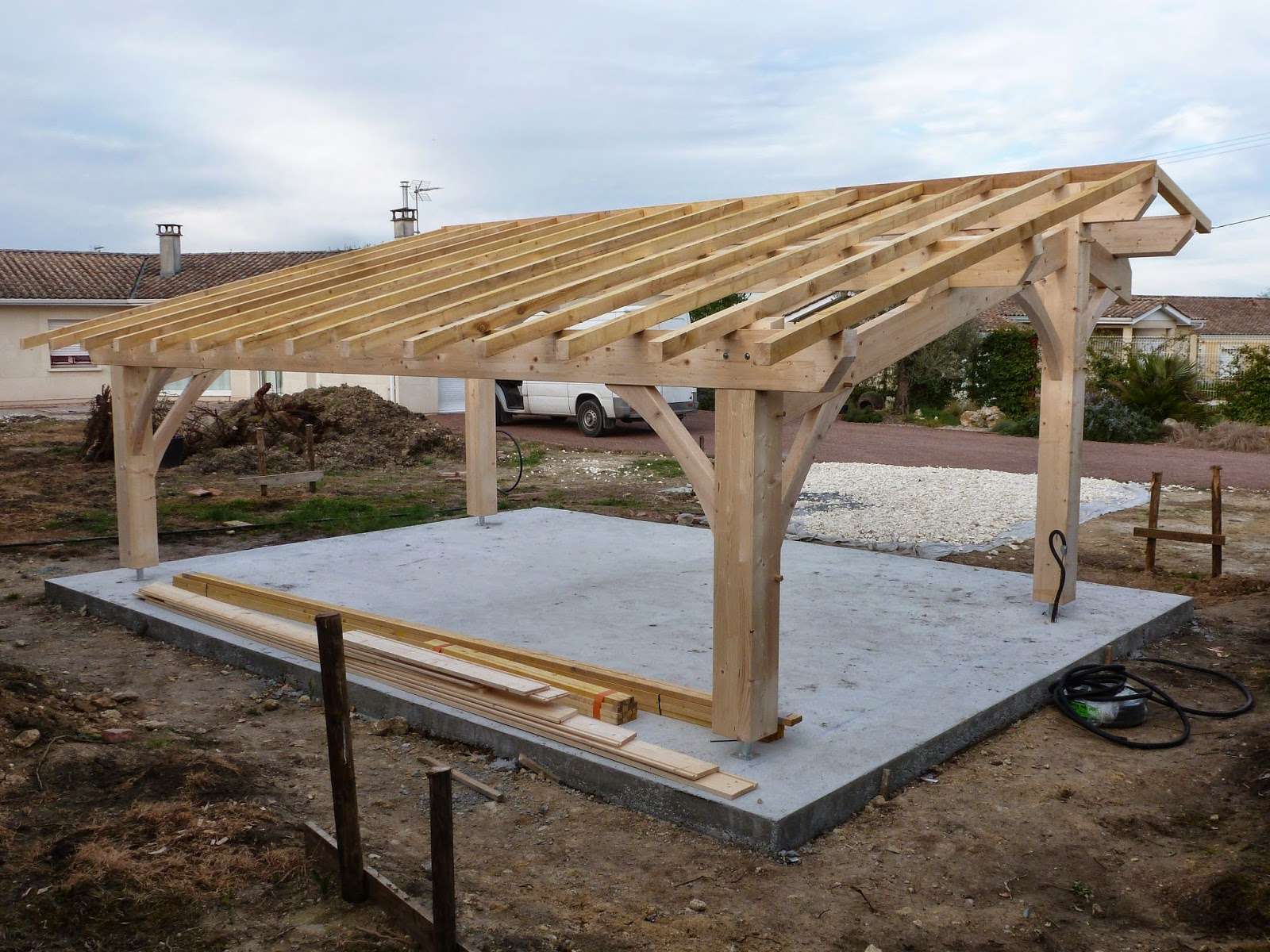 Construction d 39 un carport bois 2 voitures for Voiture pret garage