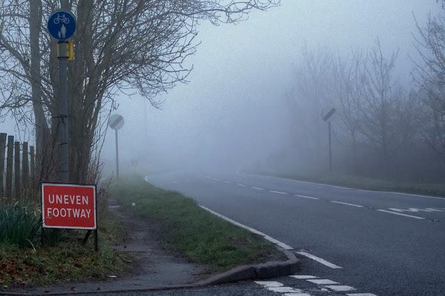 uneven footway sign