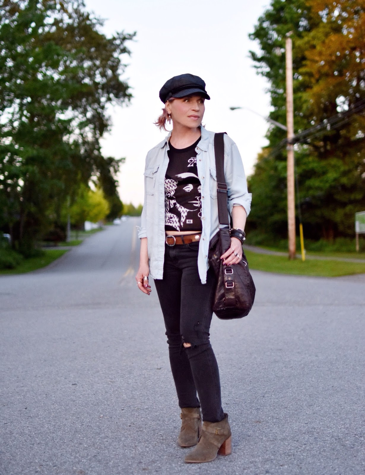 Monika Faulkner outfit inspiration - styling a graphic top and black skinnies with ankle boots, a chambray shirt, and a baker boy cap