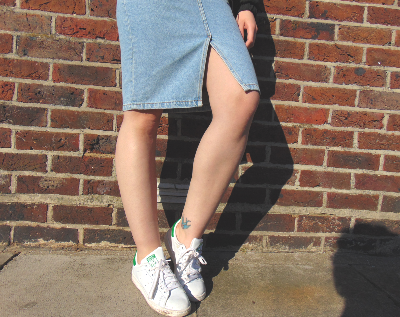 denim skirt, denim midi skirt, denim pencil skirt, stan smiths, lace up top, lace up body, spring outfit, sport luxe, round reflective sunglasses, bomber jacket, alternative fashion style inspiration