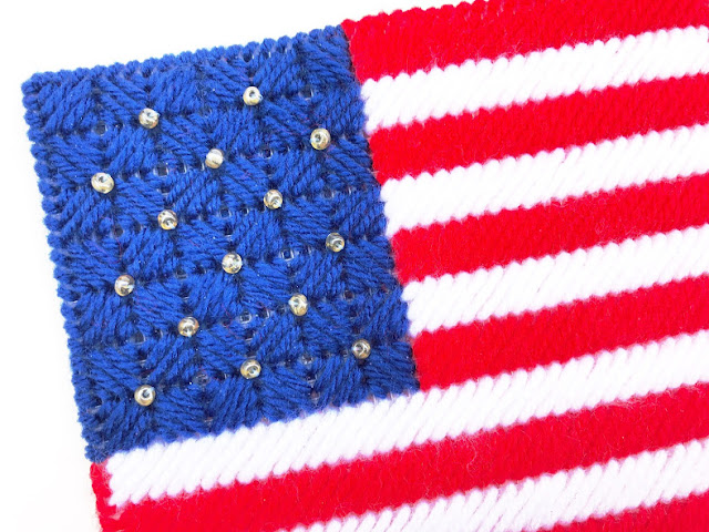 "Decorate for a patriotic summer with these easy plastic canvas pattern. This USA flag napkin holder will take your dessert table or picnic table from ""cool"" to ""amazing""! This pattern stitches up in no time at all to leave you enjoying the party with your guests."