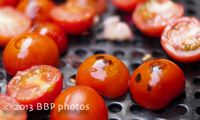 Blistering the tomatoes on the grill, using this device, keeps the tomatoes from falling through.