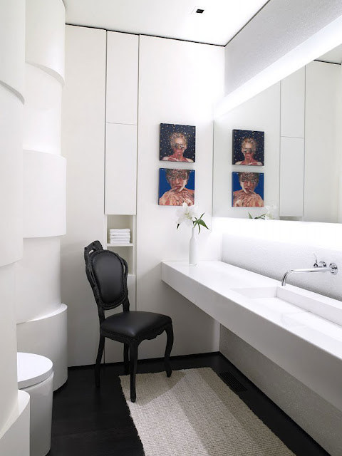 White bathroom and single black chair in the Aspen Residence by Stonefox