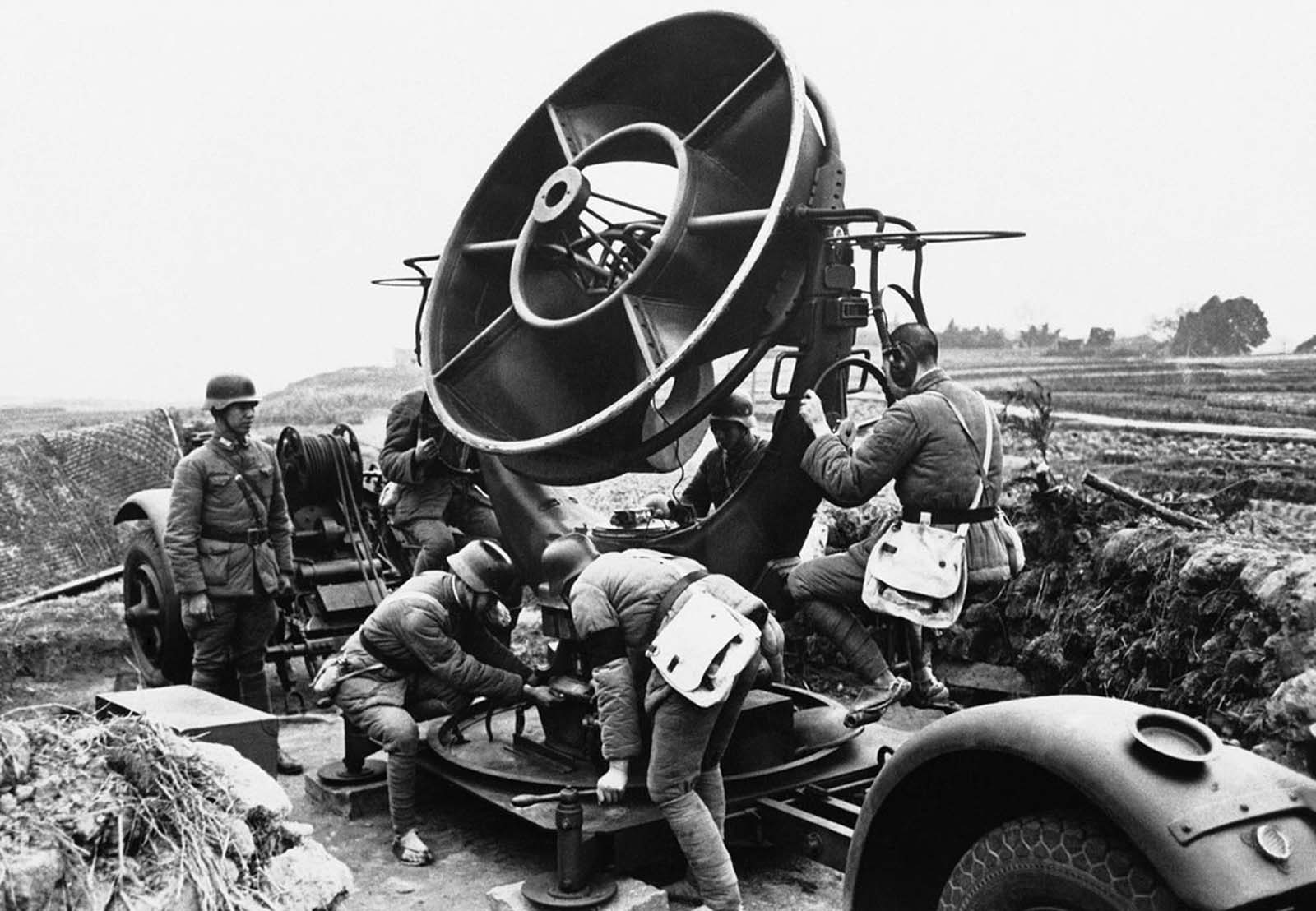 Chinese soldiers man a sound detector which directs the firing of 3-inch anti-aircraft guns, around the city of Chongqing, China, on May 2, 1941.
