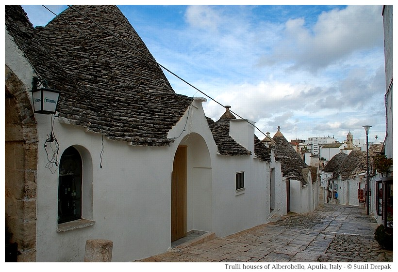 Alberobello - a street of old town with trulli houses - Photographs by Sunil Deepak