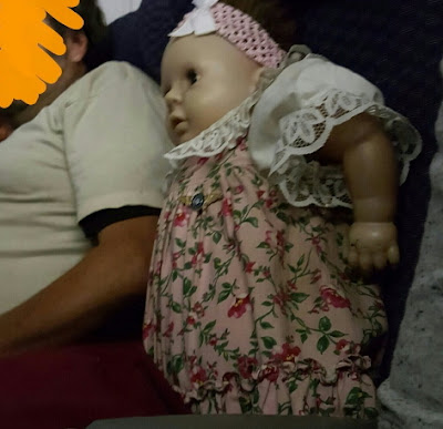 man buys plane ticket baby doll