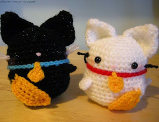 http://www.craftsy.com/pattern/crocheting/toy/amigurumi-maneki-neko-lucky-cat-/43791