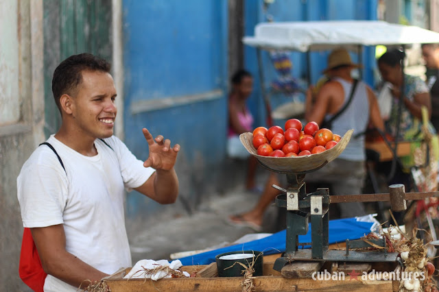 A man selling fresh produce on the streets of Old Havana, Cuba