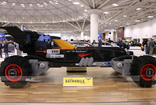 a picture of a Lego Batmobile at the Twin Cities Auto show