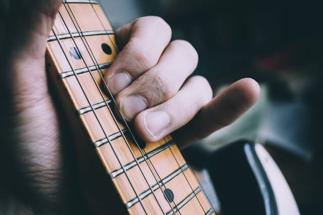 Photo-of-Person-Playing-The-Guitar