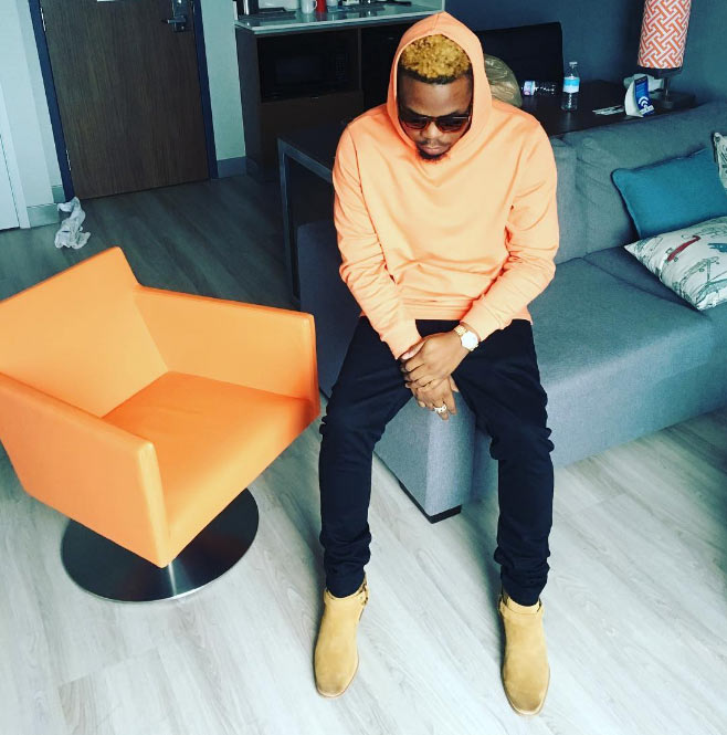 Olamide looking good in his dyed hair