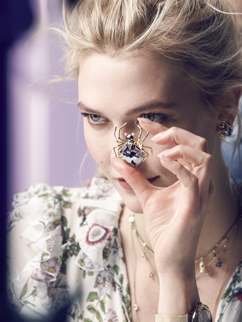 Karlie Kloss shows off a spider pendant on set of Swarovski winter 2018 shoot