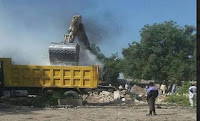 THE SECRETARIAT OF THE PEOPLES DEMOCRATIC PARTY (PDP) LOCATED AT DANDAL WAY, MAIDUGURI WAS DEMOLISHED BY A COMBINED TEAM OF MOBILE POLICE FORCE