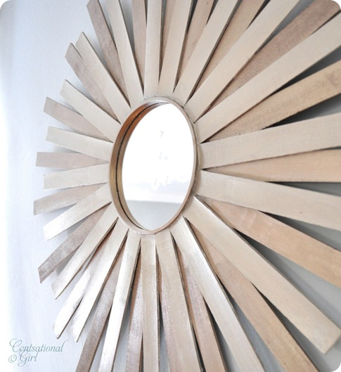 This dynamic arrangement of paint sticks makes for a great modern mirror.