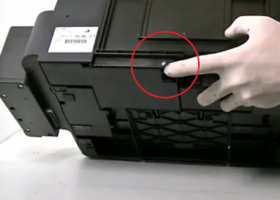 remove the screws shown with your finger