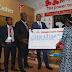 Mshindi Wa Milioni Mia Moja za Vodacom M-Pawa Akabidhiwa Kitita Chake.