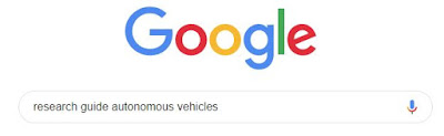 Photograph of Google with research guide autonomous vehicles typed into search bar.