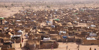 A refugee camp in Chad: Finding shelter will be harder as climate refugee numbers mount. (Image Credit: MarkKnobll, via Wikimedia Commons) Click to Enlarge.