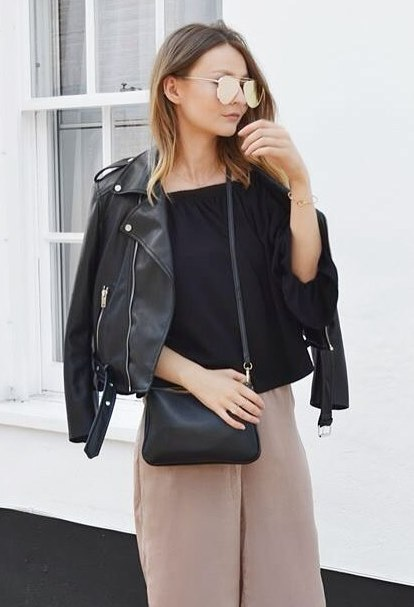 best fall outfit idea with a biker jacket : black top + bag + blush wide pants