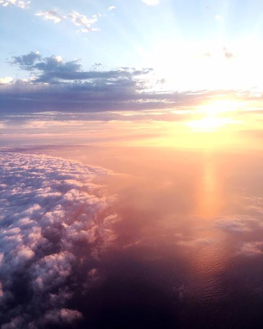 Sunset over the Pacific Ocean on Delta Flight