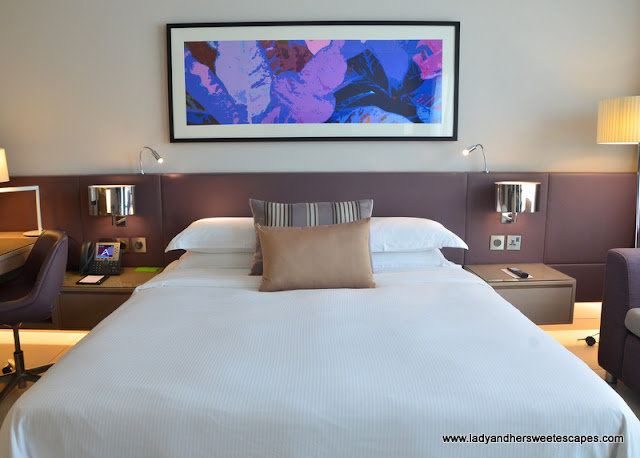 cozy king bed at Capital Centre Arjaan by Rotana