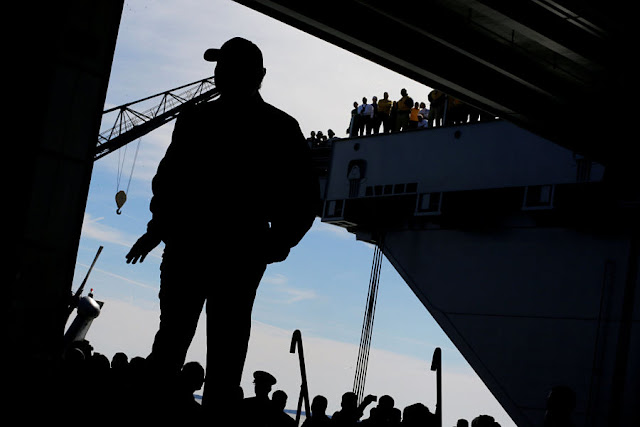 FILE PHOTO: U.S. President Donald Trump takes the stage in the flight hangar to deliver remarks aboard the pre-commissioned U.S. Navy aircraft carrier Gerald R. Ford at Huntington Ingalls Newport News Shipbuilding facilities in Newport News, Virginia, U.S. March 2, 2017. REUTERS/Jonathan Ernst/File Photo