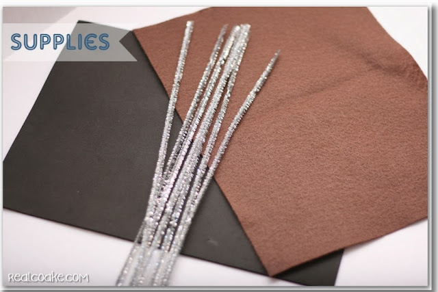 black foam, brown felt and sliver chenille stems