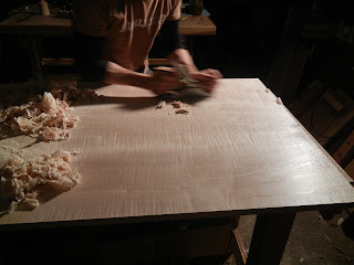 Matthew Wolfe Furniture Maker hand planing a curly maple tiger maple desk top
