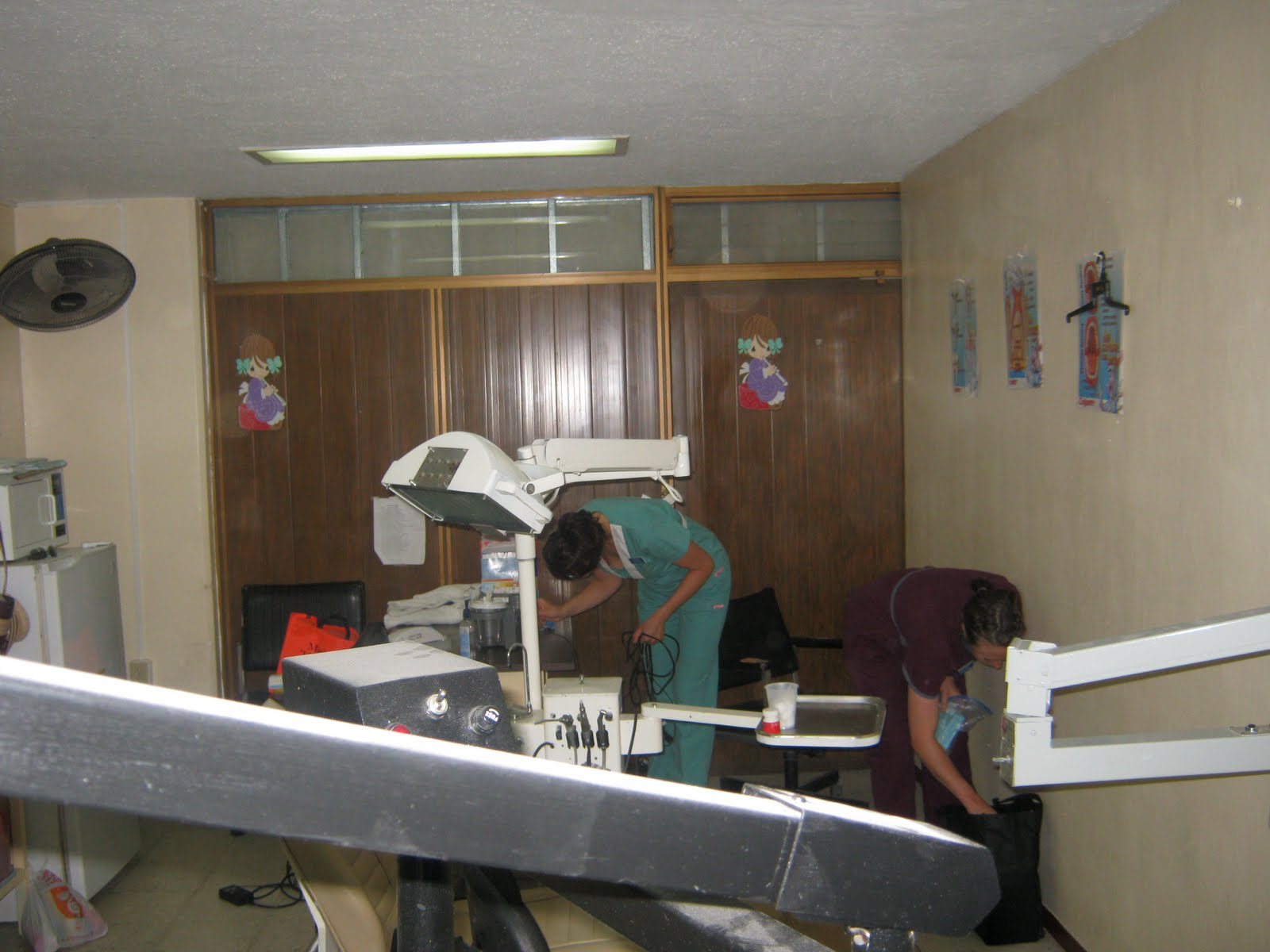 Very Cramped Quarters For Three Dental Hygienists We Had To Create A Makeshift Chair With Office Chairs The Third Person
